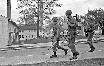 Photo: Guard walking down street near ROTC Building.
