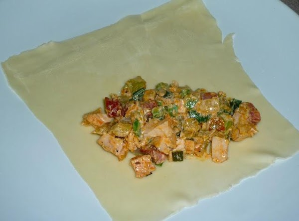 Set egg roll wrapper on a large plate, in the shape of a diamond...