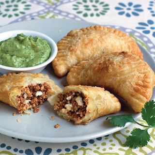 Chorizo & Cheese Empanadas with Avocado Crema.