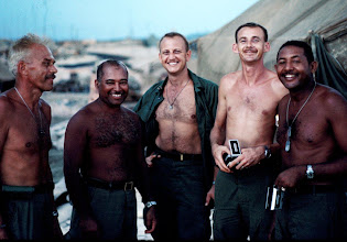 Photo: MSgt. Schroeder (L) and unidentified senior NCO's of 1/5 Cav. Charlie Brown Picture.   Willie Hightower of Macon GA is center.