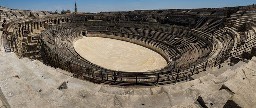 The Arena of Nîmes is a Roman amphitheater in Nîmes in the south of France. Built around AD 70, it was remodelled in 1863 to serve as a bull ring.
