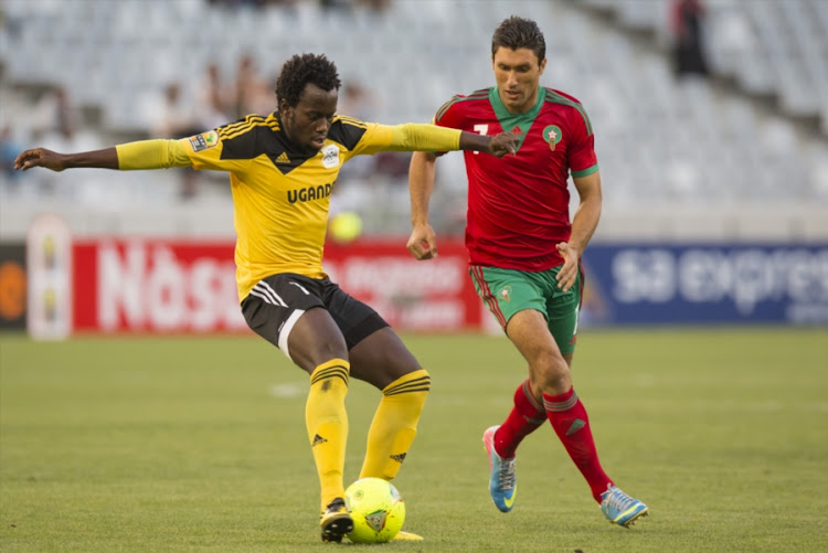 A file photo of Savio Kabugo (left) and Brahim El Bahri (right) during the 2014 African Nations Championship match between Morocco and Uganda at Cape Town Stadium on January 20, 2014 in Cape Town, South Africa.