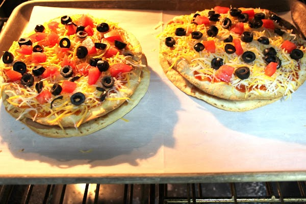 Place pizzas in 350 degrees F oven on a cookie pan/flat pan and bake...