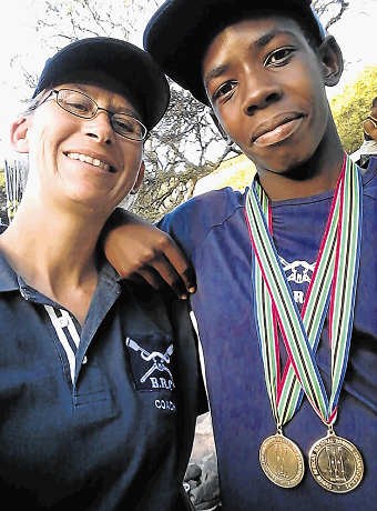Lukho Mbongisa of Duncan Village, right, who has been selected to the SA Junior Club rowing team, with his coach, Jean Ellingson, after the 2017 SA National Rowing Championships