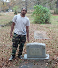 Photo: Kamau at his paternal great-grandfather's grave. Kamau's middle name is Curtis. His maternal grandfather was also named Curtis.