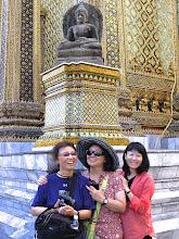 Photo: Jennifer, Jessica and Etsuko pose under the ancient Borobudur stone Buddha at Wat Phra Kaew.