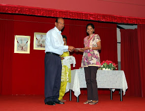 Photo: Miss Kavitha receiving the Scholarship Award