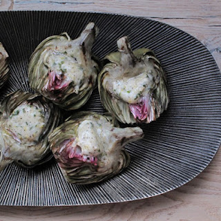 Grilled Artichokes Topped with Mint, Lemon and Garlic Compound Butter