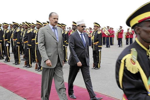 Eritrean President Isaias Afwerki, left, walks besides the Somalian President Mohamed Abdullahi Mohamed during a welcoming ceremony on his arrival for a visit to Eritrea, in Asmara, Eritrea, on July 28 2018. Picture: OFFICE OF PRESIDENT OF THE REPUBLIC OF SOMALIA/HANDOUT VIA REUTERS