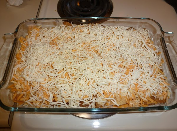 Line the crepes in a rectangular oven pan seam side down. Spread the shredded...