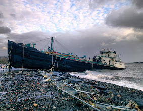 Photo: A 168-foot water tanker, the John B. Caddell, sits on the shore Tuesday morning, Oct. 30, 2012 where it ran aground on Front Street in the Stapleton neighborhood of New York's Staten Island as a result of superstorm Sandy. (AP Photo/Sean Sweeney)