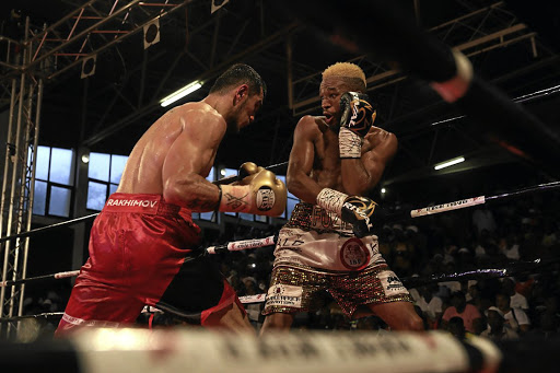 Azinga Fuzile in a clash with Russian Shavakat Rakhimov at the Orient Theatre in East London last month. Fuzile handlers have dismissed claim that he is an alcoholic / ALAN EASON