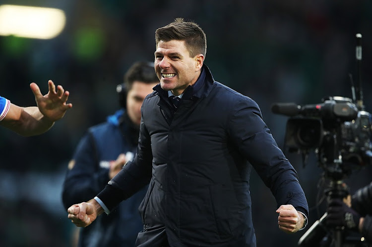 Rangers coach Steven Gerrard has won the club their first Scottish Premiership title since 2011.