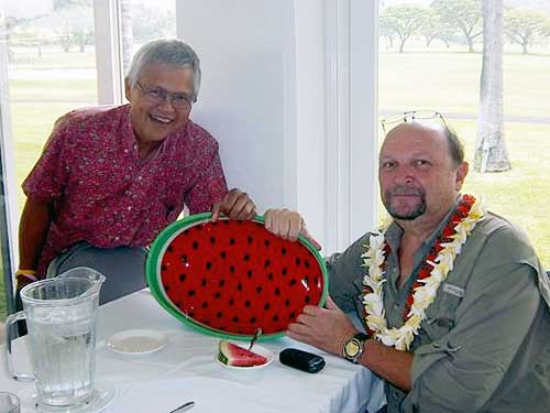 Photo: Curveball (right) officially passes the tailgate watermelon dish to sj-macro (left). Curveball is moving back to California. Aloha Cattle Call for Curveball at Hale Ikena, June 23, 2011