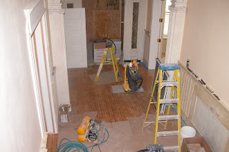 Photo: July 2006 - Month 35: Front hall - floor sanded and wainscotting being repaired and prepared for paint