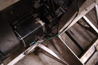 Photo: Photo showing disassembly of front-right lift rail bracket.