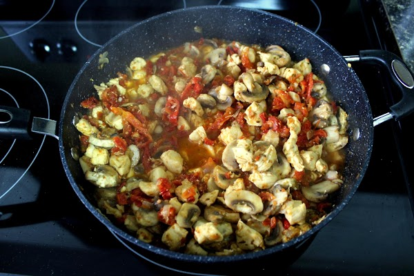 Add the mushroom, sun-dried tomatoes, oregano, salt and pepper. Cook until the wine reduces...