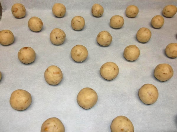 Using hands, form mixture into small balls and place on ungreased cookie sheets or...