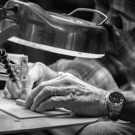 Close up of hands on a scroll saw - BW by Jackie Nix - Black & White Portraits & People ( wood working, folk art, art, work shop, hands, elderly, craftsman, craft, scroll saw, fair, faceless portrait, light, watch, monochrome, wood, hobby,  )