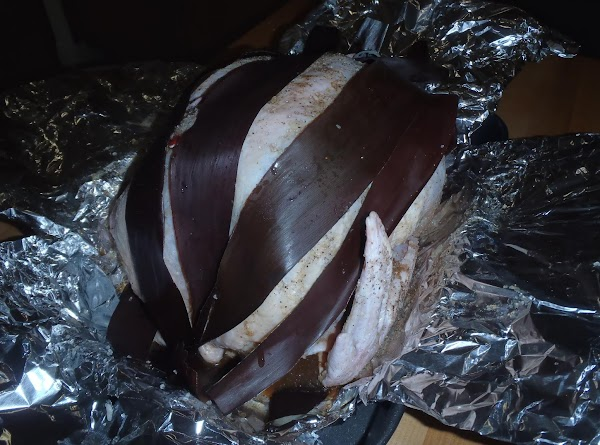 In a large roasting pan, take a 3-4 ft section of aluminum foil and...
