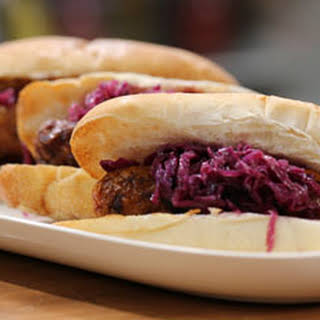Beer Glazed Grilled Bratwurst with Wilted Red Cabbage Slaw.