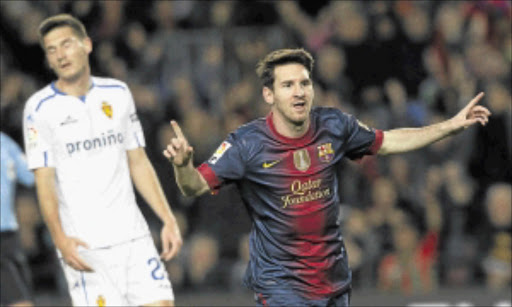 ON THE DOUBLE       : Barcelona's Lionel Messi celebrates a goal against Zaragoza.        pHOTO: REUTERS