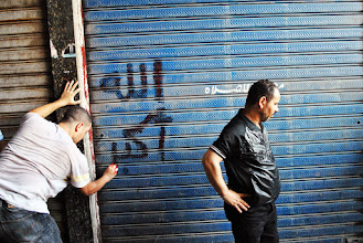 Photo: A man writes the Arabic words 'Allahu Akhbar' in a killed protester's blood after violence breaks out during Friday's 'Day of Rage' protest. At least 95 people are reported killed in the clashes. Cairo, EGYPT - 16/8/2013. Credit: Ali Mustafa/SIPA Press