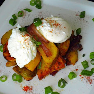 Laddle Poached Eggs Over Steak Home Fries.
