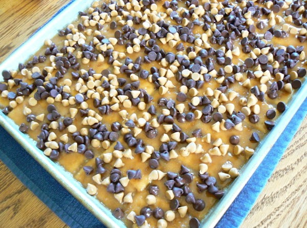 Mix together the chocolate and butterscotch chips and sprinkle over top of butter crackers....