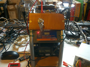 Photo: I now have most of the wiring done. I am using a spare ignition switch. To the left connects the battery and charger together. The red light indicates the charger is receiving power.
