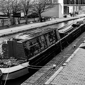 Awaiting restoration by Carol Henson - Black & White Street & Candid ( mono, 2019, barge, january, oxford canal, black and white, banbury, ruin, water, boat )