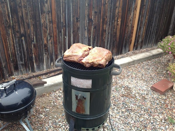 Prep your smoker and place meat on the top level.  Smoke at 200...
