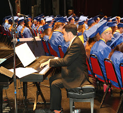 Photo: Rob Pacillo director of High School Jazz ensemble Plays a musical inturlude.
