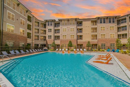 Verus' resort-style swimming pool at dusk