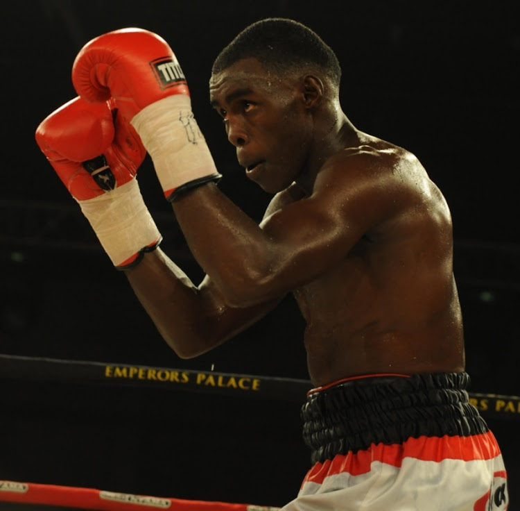 Xolisani Ndongeni during the Lightweight bout between Xolisani Ndongeni and Mzonke Fana at Emperors Palace on June 06, 2015 Kempton Park.