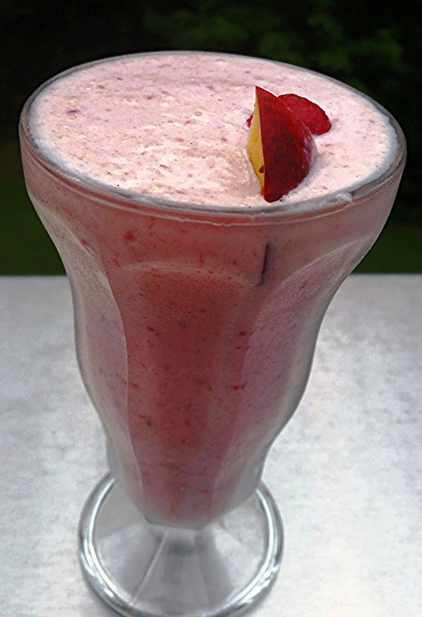 Pour into favorite chilled glasses, add a fresh peach slice and a raspberry if...