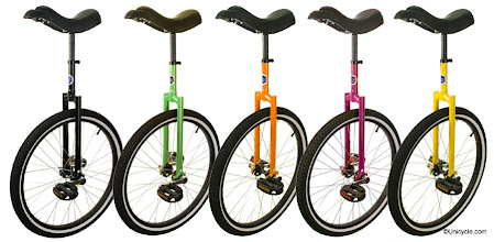 Photo: 24 inch Club Unicycles in Black, Green, Orange, Purple and Yellow.