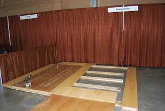 Photo: installing a torsion box sandwich core trade show floor is easy with our large lightweight panels. Sing panels also make great prefab floors in offices, factories, clean rooms stage and more.