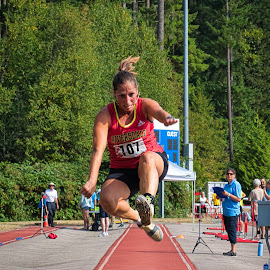 Running Hard To Jump by Garry Dosa - Sports & Fitness Other Sports ( running, woman, sports, motion, long jump, outdoors, games, track and field, action, athletes, female, people )