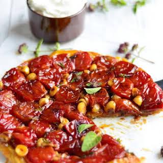 Cherry Tomato Tart Tatin with Honey, Hazelnuts and Oregano.