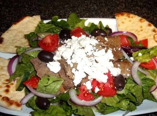 build your salad:  add lettuce to plates, onion, olives, cucumbers, tomatoes, meat, feta...