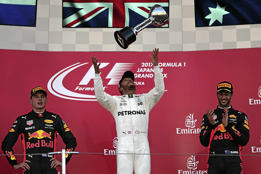 Lewis Hamilton extends his 2017 championship lead after winning the Japanese Grand Prix.