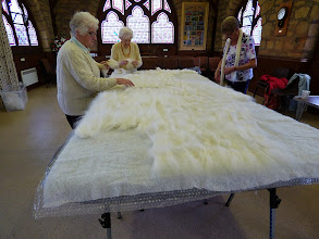 Photo: arranging the first layer of white merino fibres for the background