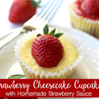 Strawberry Cheesecake Cupcakes with Homemade Strawberry Sauce.