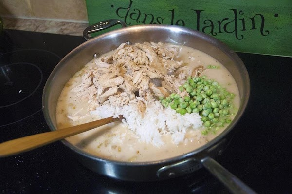 Reduce the heat to low, and add the shredded chicken, the soup base, and...