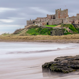 Bamburgh Castle by Darrell Evans - Buildings & Architecture Public & Historical ( castle, cliff, defence, battlements, historical, tourism, clouds, scenic, building, sea, towers, bamburgh castle, dunes, defend, uk, entrance, landmark, ruin, architecture, tower, historic, old, medieval, turret, heritage, history, ancient, water, stone, outdoor, fortress, ocean, seaside, northumberland, beach, fort, gate, fortification, no people, stronghold, wall, cliff-face )