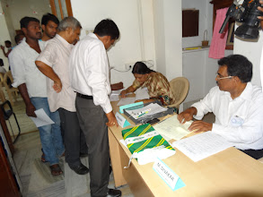 Photo: Election Officer verifying the names in the voter list - GHMC Elections