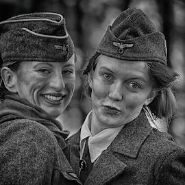 by Marco Bertamé - Black & White Portraits & People ( german, couple, woman, portrait, two, pair, smile, uniform, cap, ww2, headshot, ladies, military, duo )