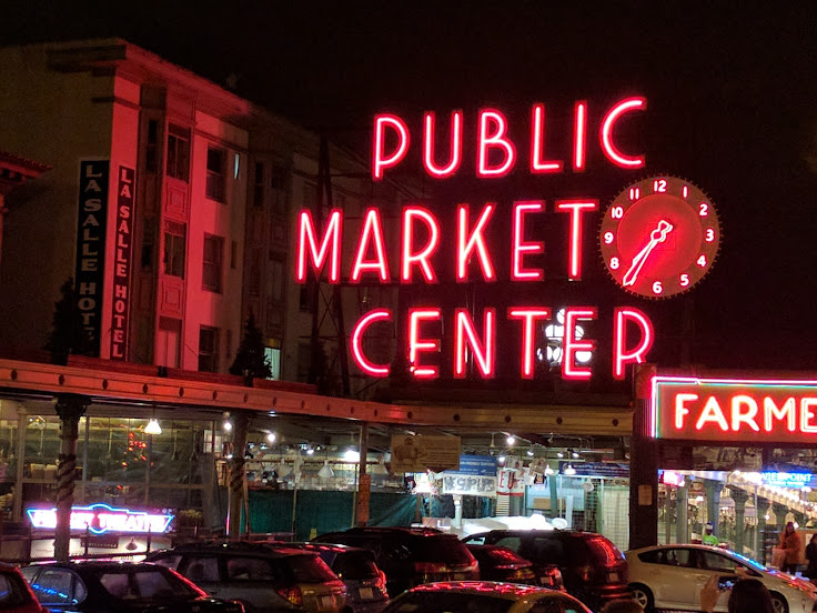 "The LaSalle Hotel to the left of the ""Public Market Center"" sign."