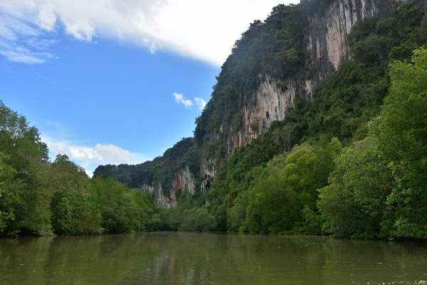 Enter the hidden lagoon surrounded by steep limestone cliffs